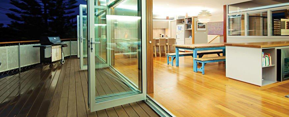 A Bi-fold Door opening out onto a deck & Doors - Acme1 Glass u0026 Aluminium